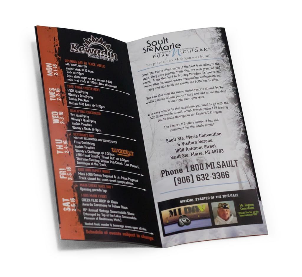 Double parallel brochure half open